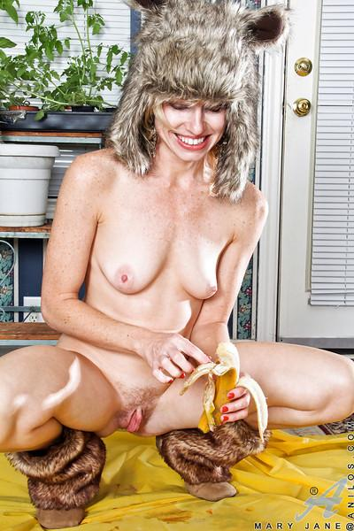 Naughty blonde MILF with slim curves undressing andd teasing her gash