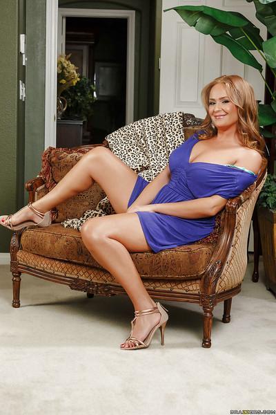 Buxom housewife Dani Daniels hikes dress to flash big butt in white panties