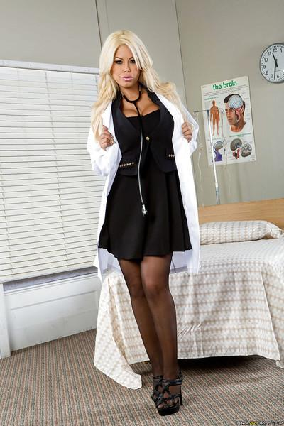 Stunning blonde doctor with smoky eyes revealing her goods in her office