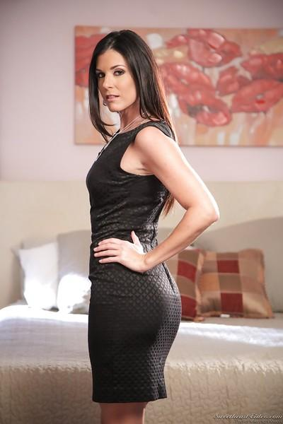Graceful MILF with trimmed cooter getting rid of her black dress and lingerie