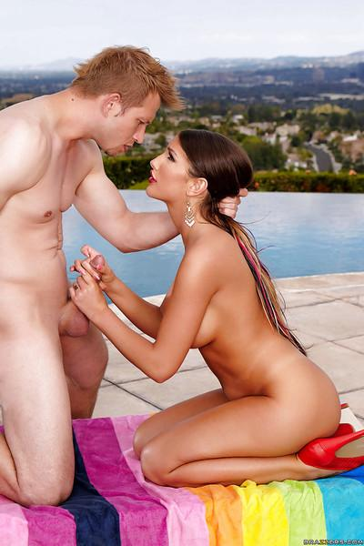 Hot Latina babe model August Ames jerks off a cock onto big tits for money