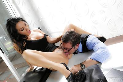 Busty high heeled Asian pornstar Asa Akira giving blowjob in office