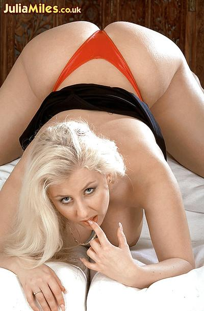 Blonde MILF solo model Julia Miles removing panties for masturbation action