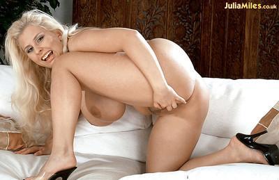 Blonde MILF solo model Julia Miles removing panties for masturbation action