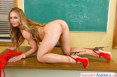 Milf babe Nicole Aniston stripping out of red lingerie in classroom