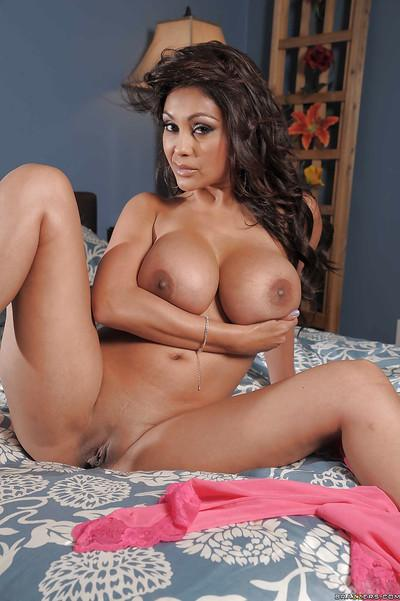 Curvaceous indian MILF Priya Anjali Rai stripping on the bed