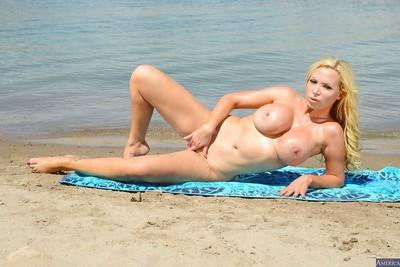 European blonde Nikki Benz is posing on the beach so freaking nasty