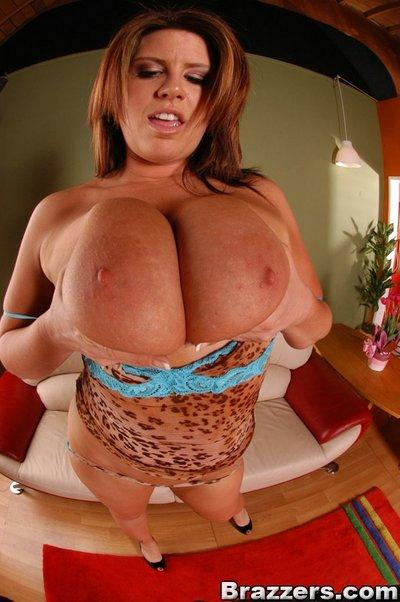 Busty MILF Lisa Sparxxx takes off lingerie and masturbates her clit