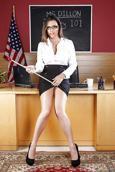 Skinny milf with big forms Danica Dillan is posing in the class room