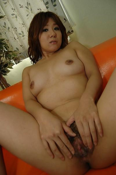 Naughty asian MILF undressing and spreading her pussy lips in close up