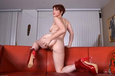 Redhead MILF Lily Cade exposes hairy pussy in high heels for spreading