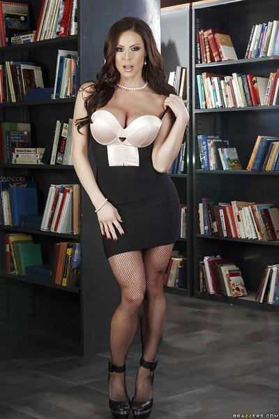 MILF in glasses Kendra Lust posing in sexy work skirt and brassiere