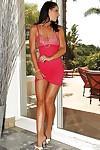 Adorable brunette Angel Dark revealing her ravishing body outdoor