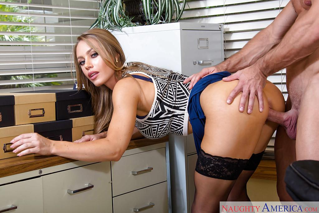 image Highheeled teacher smoking and playing on desk