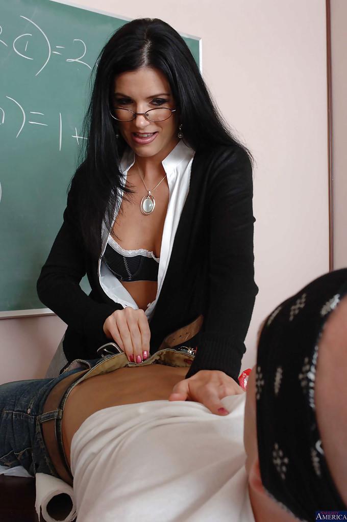 Dark haired teacher sucks student