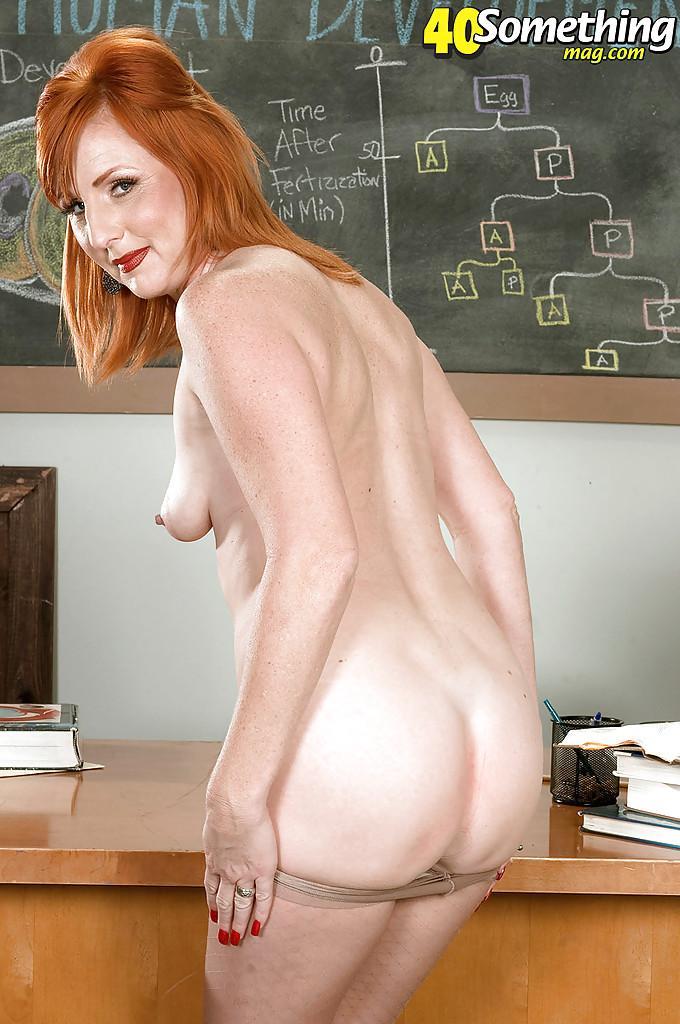 Hot Redhead Teacher On The Desk Receives Her Love