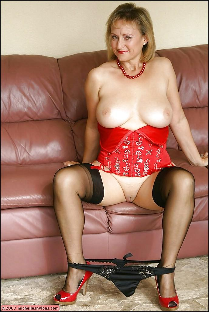 busty mature lady in stockings and red corset strips down