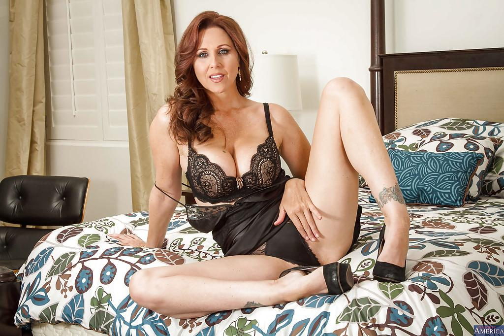 Milf Julia Ann takes off her luxury lingerie right in the