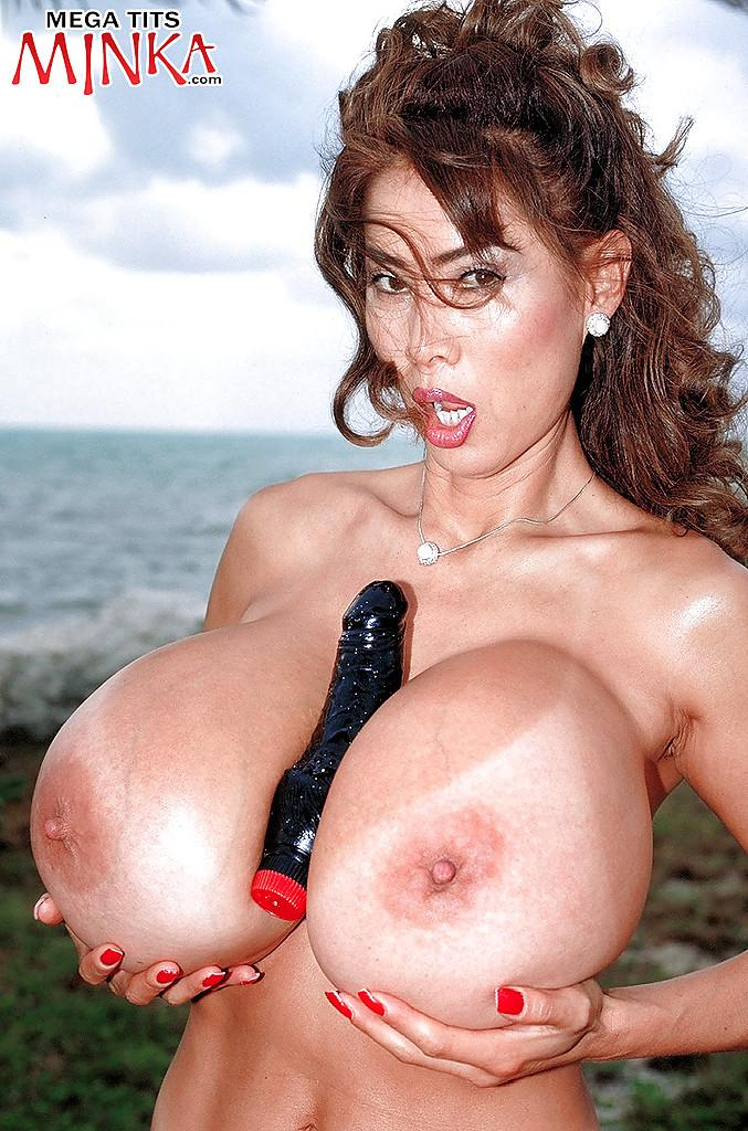 ... Asian babe Minka exposing massive juggs outdoors before anal toying ...