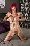 Gorgeous redhead MILF Anna Bell Peaks exposes her sexy inked up body