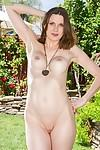 Close up posing of the perfect milf babe Valerie Voxx in her yard