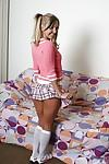 Innocent blonde teen Aaliyah Love taking off her skirt and spreading