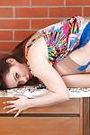 European mummy Olga Cabaeva letting upskirt pubic hairs escape panties