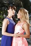 Dana DeArmond and Carter Cruise are kissing and playing outdoors