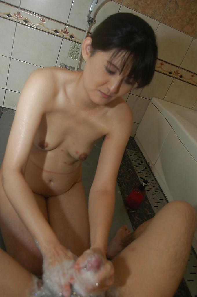 Sassy asian MILF gives a soapy handjob and blows a stiff ...
