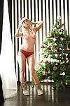 Blonde Euro babe Carla Cox strutting topless in boots at Christmas