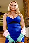 Blonde babe Briana Banks unleashing large MILF tits in kitchen