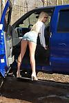 Big breasted blonde MILF Barbi Sinclair shows her hot body outdoors in hot mini skirt.