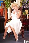 Vintage pin-up model Codi Carmichael takes off her sexy white dress