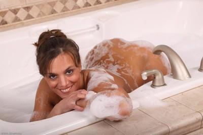 Hot passionate milf having fun in a hot tub