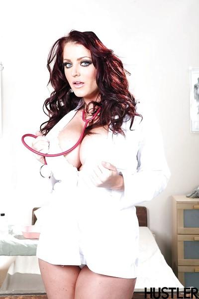Dark hair babe Sophie Dee strutting in OTK socks and nurse uniform
