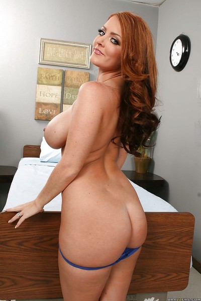 Spectacular redhead Sophie Dee with largest boobs and butt shows love-cage stretching