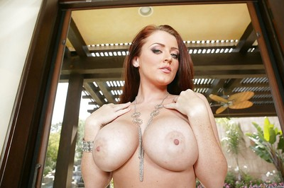 Pornstar redhead queen Sophie Dee shows her appealing scones outdoor