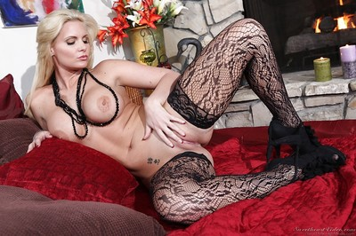 Blonde babe Phoenix Marie posing in extreme black underclothes and high heels
