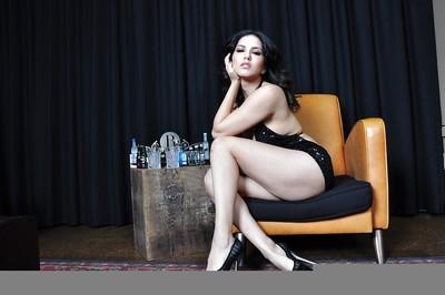 Meaningful vixen in provocative dress revealing her marangos and vagina
