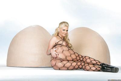 Glamorous blond MILF Phoenix Marie posing in erotic nylon outfit