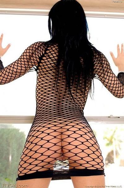 Kinky body mesh outfit on appealing brunette