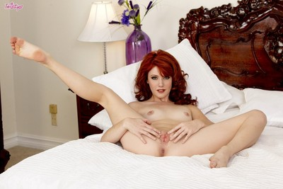 Teen redhead elle alexandra caresses her pussy at the daybed