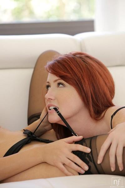 Perspired redhead licks her girlfriend