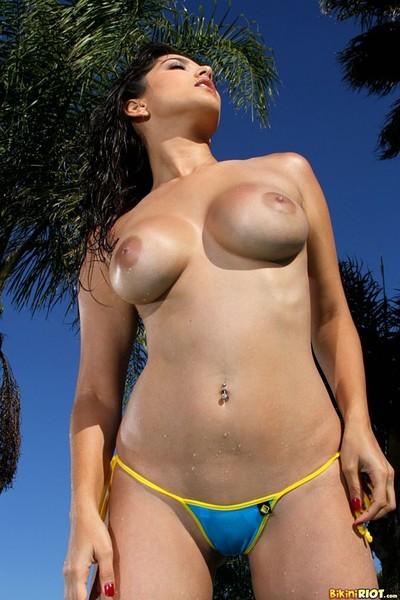 Endearing leone rocking her blue thong bikini by the pool