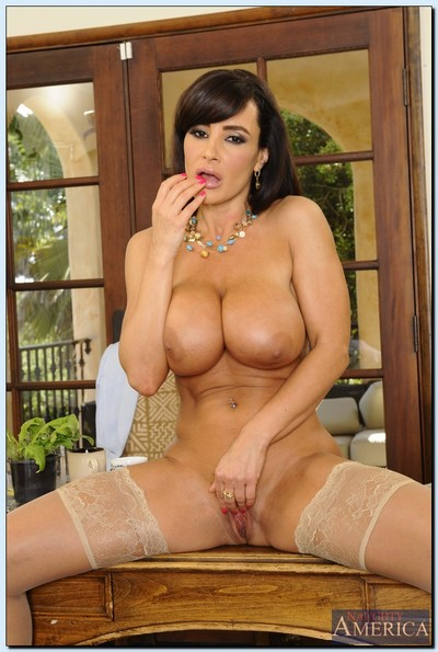Captivating calm teacher Lisa Ann getting naked and exposing her snatch