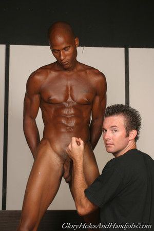 Cute bloke playing round huge black cock in uncaring interracial action