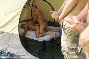 Horny individuals jump on the top of a beefy jock and turn him into a sex slave at a campground.