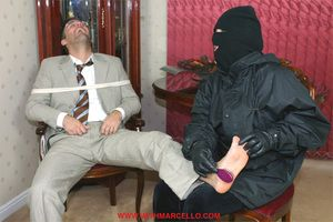 Hunk tied to a chair and tickled until he plays with his cock