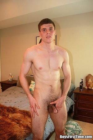 Hot young girder jerks off in his bed plays with his ass and cums