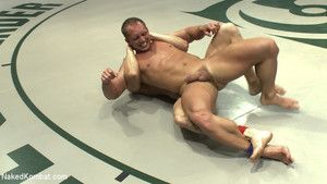 Huge bodybuilder with a big fat cock fights coupled with fucks a hot ripped blond stud.